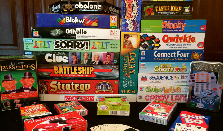 This is an image of board games stacked on a table.
